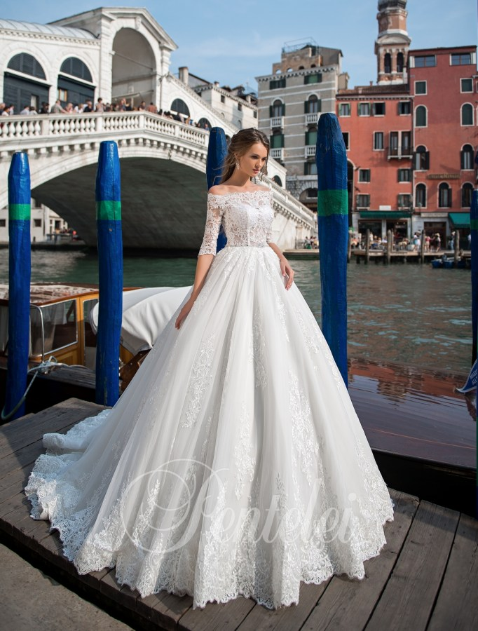 Voluminous embroidered wedding dress with uncovered shoulders on wholesale